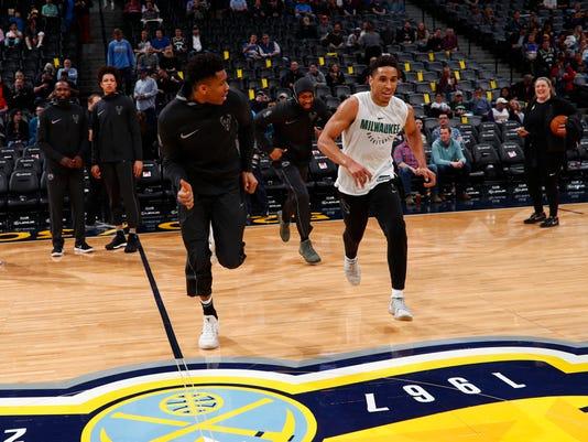 Milwaukee Bucks forward Giannis Antetokounmpo (34), Milwaukee Bucks guard Malcolm Brogdon (13)