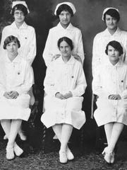 In 1927, Susie Walking Bear (back row, center, with
