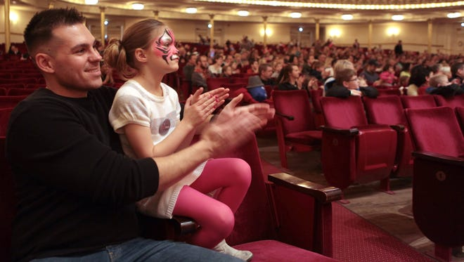 The Enquirer/Cameron Knight Gordon Green of Madeira and his daughter, Isabella, 7, applaud a circus performance at Music Hall during the Macy?s Arts Sampler, which showcases organizations supported by the ArtsWave Community Campaign. MACYS ART SAMPLER Sun., March 8, 2015 Gordon Green of Madeira and his daughter, Isabella Green, 7, applaud a circus performance on Sunday at Music Hall during the Macy's Art Sampler, which showcases organization supported by ArtWave's Community Campaign. The Enquirer/Cameron Knight