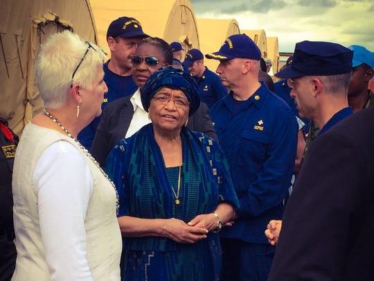 Liberian president Ellen Johnson Sisleaf (center) and Deborah Malac (left), the U.S. ambassador to Liberia, are shown visiting the U.S. Ebola fighters last fall.