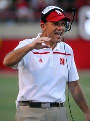 Nebraska coach Mike Riley and Keyshawn Johnson were