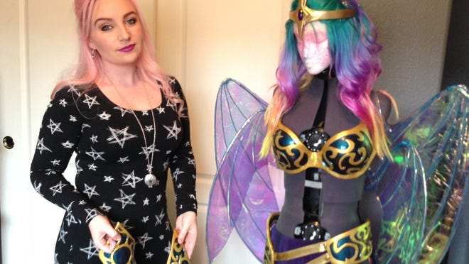 Cosplayer Mel Hoppe of Reno, also known as Wind of the Stars, poses with her costume of the character Grace, from the Soulfire game. Hoppe will appear in the exhibit hall of this weekend's Wizard World Reno Comic Con.