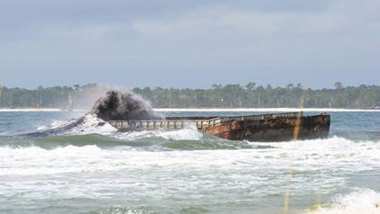 A coal barge is grounded on a sandbar near Fort Pickens on Tuesday, Jan. 9, 2018.