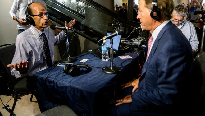 Alabama Coach Nick Saban, right, visits Paul Finebaum's, left, show as his last stop at SEC Media Days, Thursday, July 17, 2014, at the Hyatt Regency in Hoover, Ala. (AP Photo/AL.com, Vasha Hunt) MAGS OUT