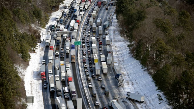 Traffic is snarled along Interstate 285 north of the metro area after a winter snowstorm on Jan. 29 in Atlanta.