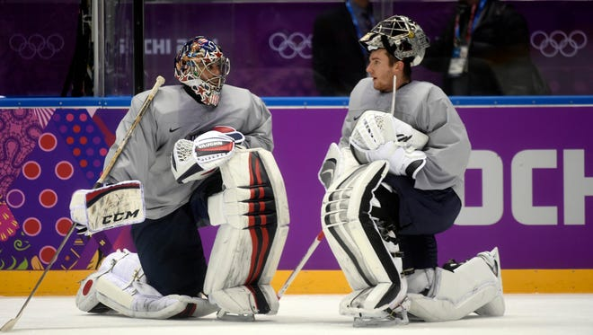 USA goalie Ryan Miller (left) talks with goalie Jonathan Quick during practice on Monday.