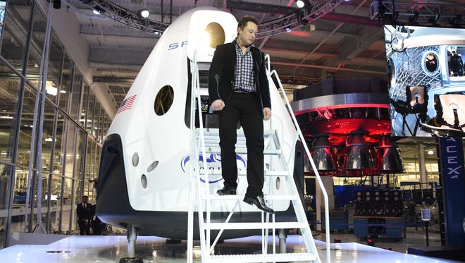 SpaceX CEO Elon Musk unveils SpaceX's new seven-seat Dragon V2 spacecraft, in Hawthorne, Calif.