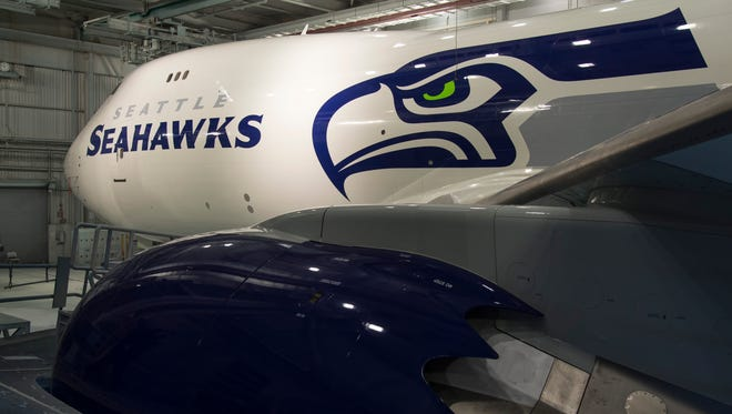 A shot of Boeing 747-8 Freighter that Boeing painted in the colors of the Seattle Seahawks NFL franchise.