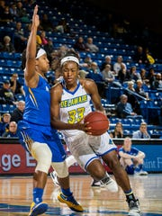 Delaware's Nicole Enabosi drives to the basket against Hofstra's Ashunae Durant in the second half of Delaware's 56-45 win at the Carpenter Center last season.