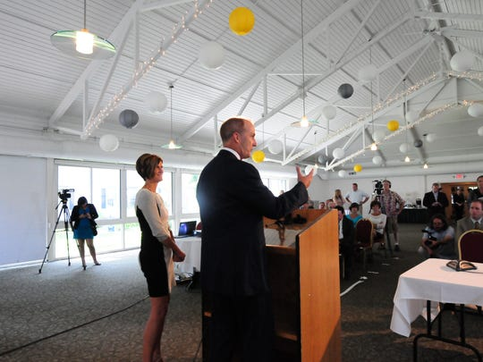 Mary Powell, president and CEO of Green Mountain Power, left, and David Crane, president and CEO of NRG, hold a press conference at the Inn at Essex on Tuesday, , as Green Mountain Power and NRG Energy, a national Fortune 250 company, announced a partnership that will establish Rutland as the Energy City of the Future and position Vermont as a leader in the movement toward cost-effective sustainable energy solutions.