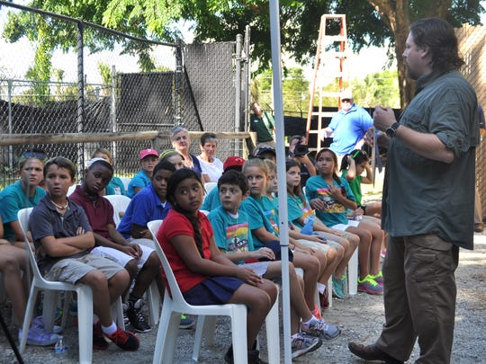 Luke Dollar, a National Geographic explorer, teaches children from Tommie Barfield Elementary School, who are at the zoo, and all other fourth graders around the country via Internet about Fosa's this past week.