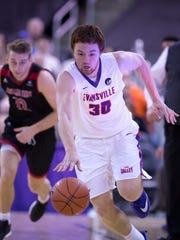Evansville's Noah Frederking (30) heads for the basket against Arkansas State at the Ford Center Friday night. The Purple Aces beat the Red Wolves 77-63.