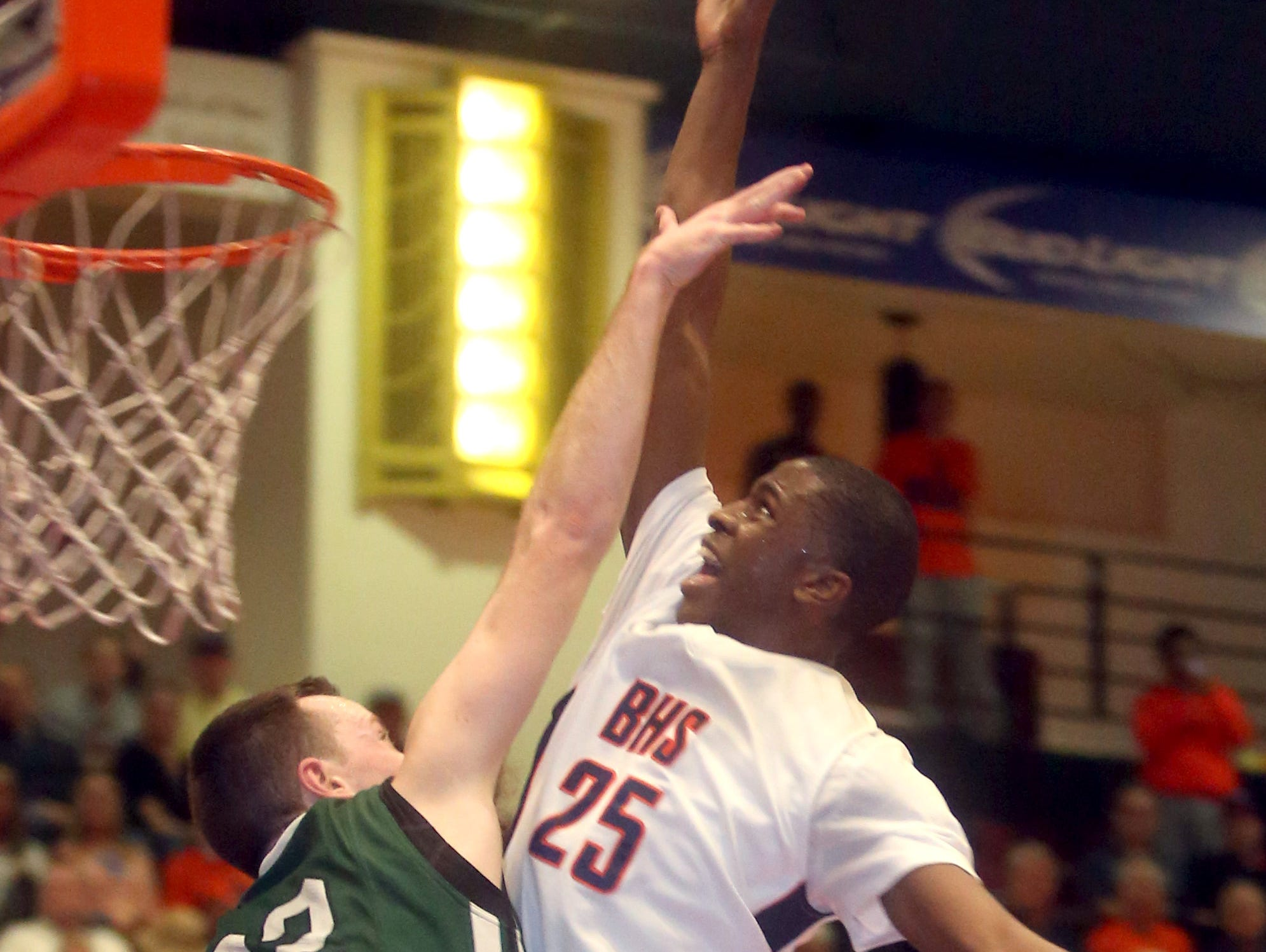 Briarcliff's Josiah Cobbs shoots over Woodlands' Kyle Smith during a Section 1 Class B semifinal basketball game at the Westchester County Center in White Plains Feb. 24, 2016. Briarcliff defeated Woodlands 65-56 to advance to the Class B final.