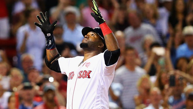 David Ortiz of the Boston Red Sox reacts after hitting a two-run homer during the eighth inning against the Minnesota Twins at Fenway Park on July 21, 2016 in Boston, Massachusetts.