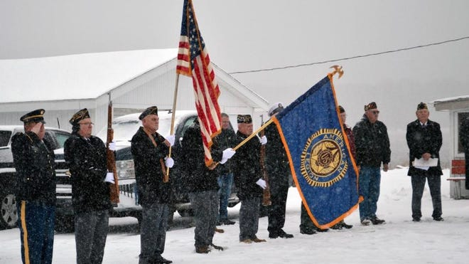 The Leighr A. Wright American Legion Post 53 color guard presents the colors during a snowy and cold Veteran's Day Ceremony in 2019.
