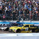 NASCAR Sprint Cup Series driver Kevin Harvick, left, beats Carl Edwards to the finish line Sunday to win at Phoenix International Raceway in Avondale, Arizona. The two cars twice bumped on the final lap.