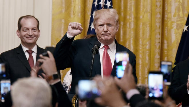 U.S. President Donald Trump speaks as Labor Secretary Alexander Acosta looks on during a Hispanic Heritage Month celebration at the East Room of the White House on Monday, Sept. 17, 2018 in Washington, D.C. (Olivier Douliery/Abaca Press/TNS)