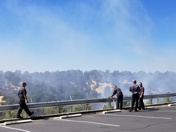 Firefighters survey area where a fire broke out at
