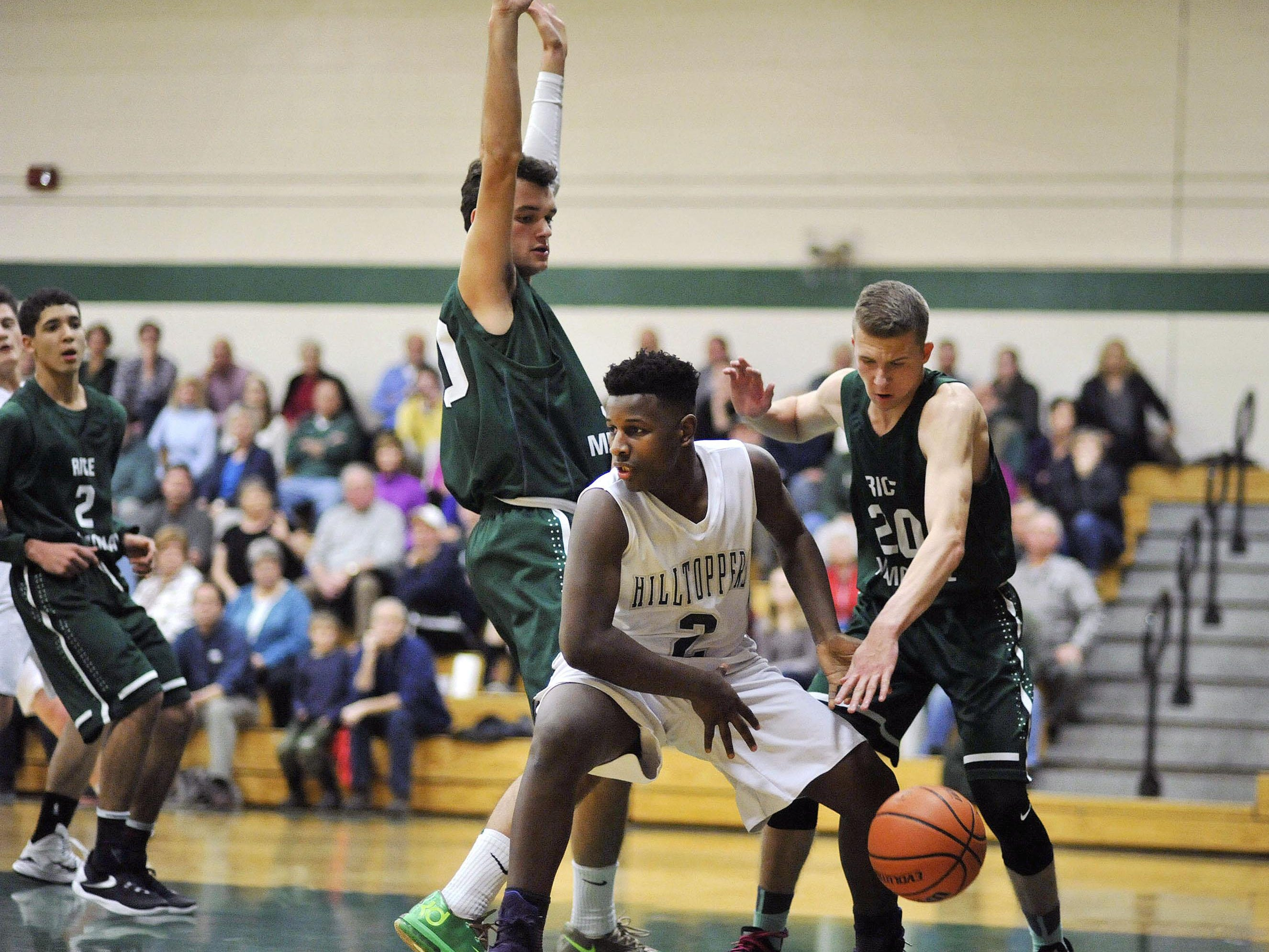 Rice's Elliot Nelson, right, strips the ball from St. Johnsbury's Nate Yates (2) during Tuesday night's high school boys basketball game in St. Johnsbury.