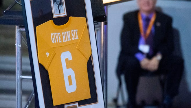 """Give Him Six"" was John Ward's famous saying when Tennessee scored a touchdown. Those words were printed on a jersey and displayed during a tribute to the late broadcaster at Thompson-Boling Arena for John Ward on Wednesday, June 27, 2018."