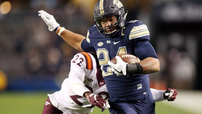 Pittsburgh Panthers running back James Conner (24) rushes the ball past Virginia Tech linebacker Terrell Edmunds (22) during the second half on Oct. 27.