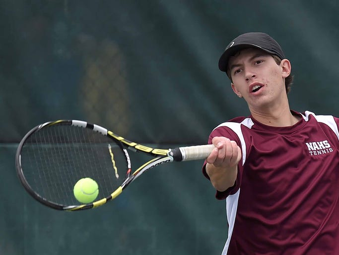 Mark Robbins of New Albany hits a forehand against Newton County.