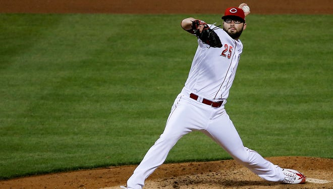 Cincinnati Reds relief pitcher Cody Reed (25) delivers in the seventh inning.