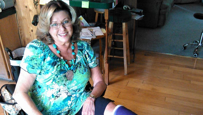 Jackie Froelich, 67, can still smile, in spite of recent trying times, which include three leg operations and the closing – hopefully temporary – of her in-home hair salon.