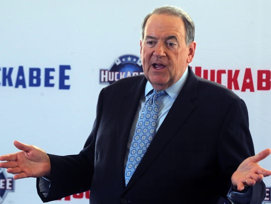 Mike Huckabee speaks during a news conference for his