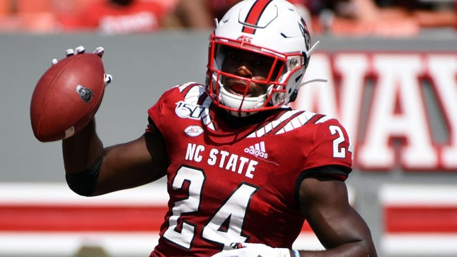 Sep 7, 2019; Raleigh, NC, USA; North Carolina State Wolfpack running back Zonovan Knight (24) scores a touchdown during the second half against the Western Carolina Catamounts at Carter-Finley Stadium. The Wolfpack won 41-0. Mandatory Credit: Rob Kinnan-USA TODAY Sports