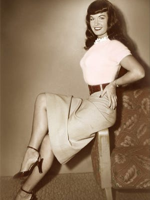 Photo from the 1950s of Bettie Page, recognized as an original pin-up poster girl.