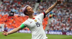 FILE - In this July 7, 2019 file photo, United States' Megan Rapinoe celebrates after scoring the opening goal from the penalty spot during the Women's World Cup final soccer match between US and The Netherlands at the Stade de Lyon in Decines, outside Lyon, France. Some athletes are criticizing the International Olympic Committee for prohibiting political protests on the medal podium. Outspoken soccer player Megan Rapinoe says she will not be silenced at the Summer Games. (AP Photo/Francisco Seco, File)