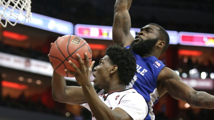 Louisville's Darius Perry drives to the basket against