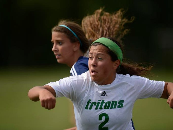 Green Bay Notre Dame's Jacque Staed (2) shields off Xavier's Meghan Goodman (8) while battling for the ball in the first half during Saturday's WIAA Div. 3 sectional finals at West De Pere High School.