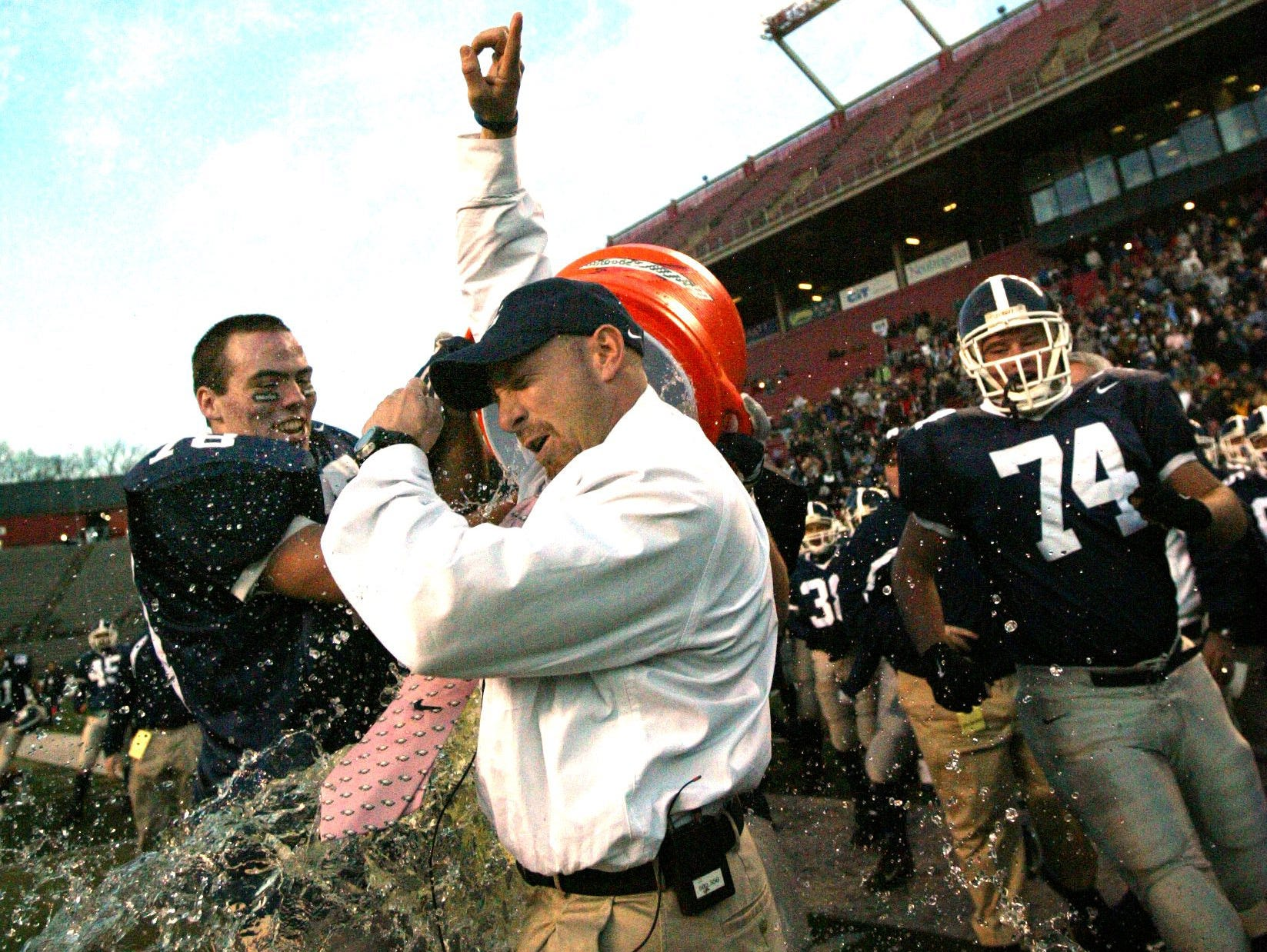 Middletown South's head coach, Steve Antonucci gets a Gatorade bath form his players after their state championship in 2006.