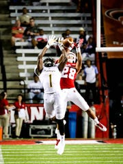 UL safety Bralen Trahan (28) goes up high in the Cajuns' season-opening win over Southeastern in 2017.
