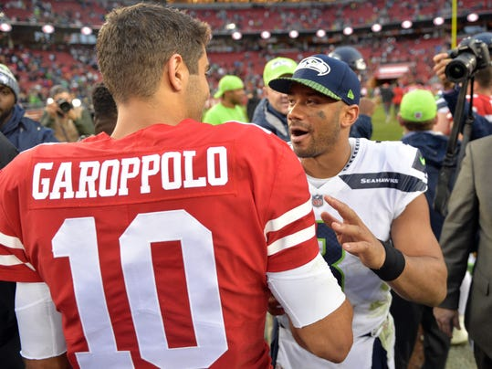 San Francisco 49ers quarterback Jimmy Garoppolo (10) shakes hands with Seattle Seahawks quarterback Russell Wilson at the end of an NFL football game Sunday, Nov. 26, 2017, in Santa Clara, Calif. (AP Photo/Don Feria)