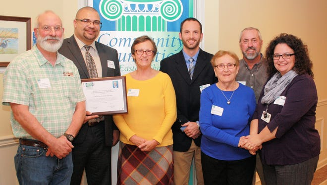 Representatives from the Mary Gay Calcott Fund and James M. Bennett High School celebrate winning the outstanding Award of Excellence from the Community Foundation of the Eastern Shore.  From left are Pete Hutchinson, Kristofer Quintana, Linda Hutchinson, Keith Donoway, Betty Wooten, Rick Wooten and Lisa Forbush.