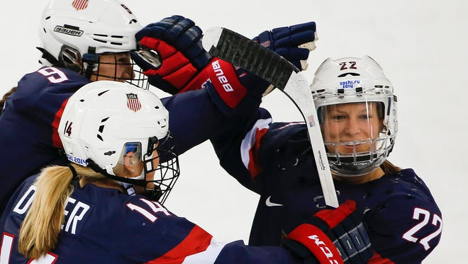 The U.S. women's hockey team is threatening to boycott the world championship because of a wage dispute.
