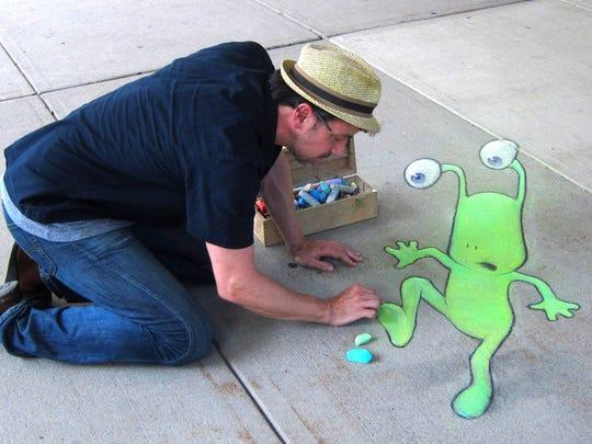 Ann Arbor chalk artist David Zinn, seen here drawing