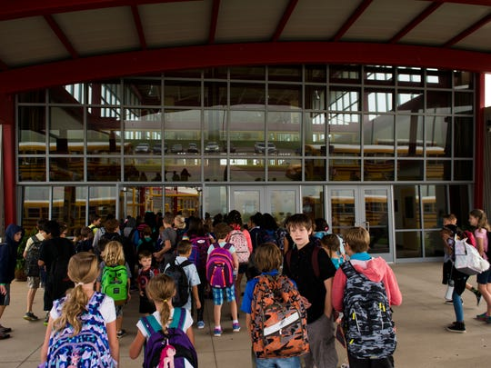 Rossview Elementary students crowd the entryway as