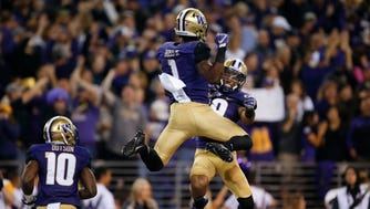Washington wide receiver John Ross, left, celebrates with teammate Andre Baccellia after a touchdown in the second quarter at Husky Stadium.