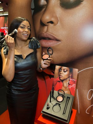 Taraji P. Henson poses with her MAC products in Chicago on Wed.