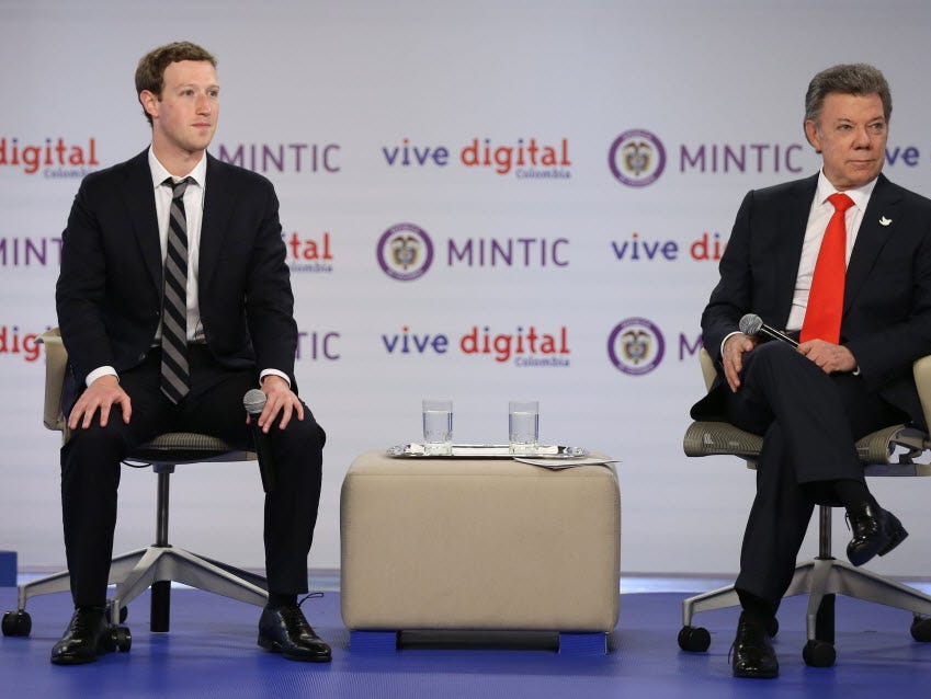 Facebook founder and CEO Mark Zuckerberg, left, and Colombia's President Juan Manuel Santos, attend an event to launch an app providing free basic Internet service via cellphone connections, at the presidential palace in Bogota, Colombia.