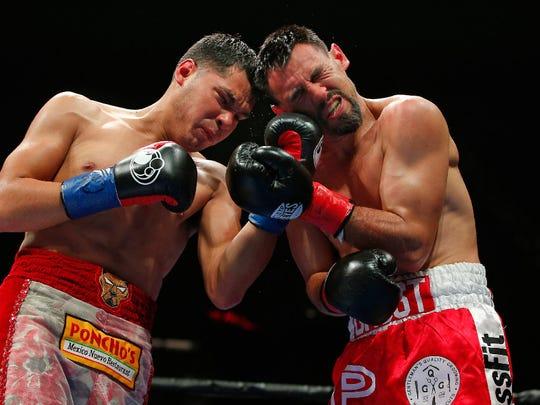 Mar Figueroa Jr., left, lands a left uppercut against Robert Guerrero en route to a third-round TKO on Saturday.