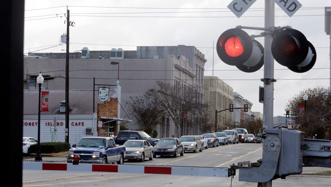 Traffic waits for a train to pass on North Main Street in Downtown Hattiesburg Wednesday, Dec. 23, 2015.