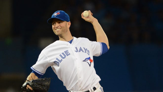 Toronto Blue Jays starting pitcher J.A. Happ delivers a pitch in the seventh inning against Chicago White Sox at Rogers Centre.