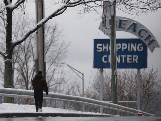A pedestrian makes his way along Route 6 in Peekskill
