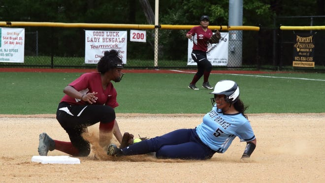 Jalia Santos (left) helped Bloomfield top West Orange, 11-1, to advance to the Essex semifinal.