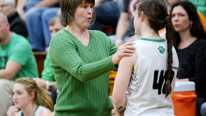 Mountain Heritage head coach Susie Shelton talks to Kylie Robinson during the game against Owen January 26, 2018.